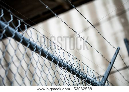 Outdoor Fence Detail Of Sharp Barbwire Installation.