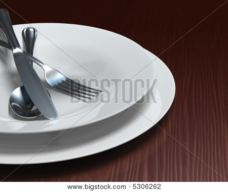 White Dishes & Cutlery On Dark Woodgrain Table
