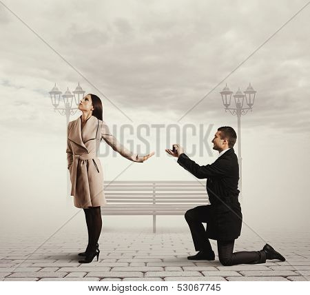smiley handsome man making proposal of marriage the woman