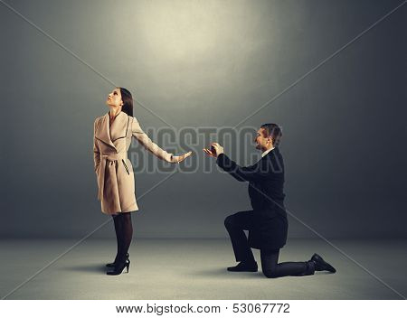 handsome man making proposal of marriage the woman