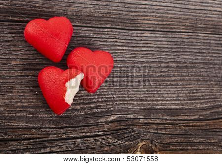 Two Love Heart Candies on crack break wood surface background, valentines day card concept