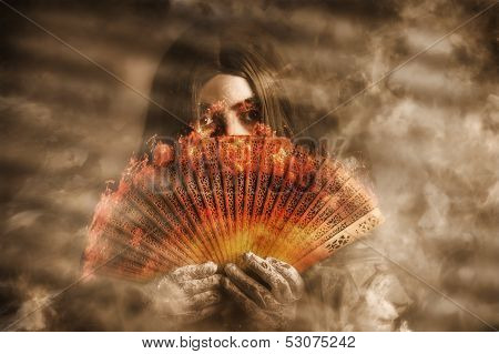 Psychic Clairvoyant Holding Mystery And Magic Fan