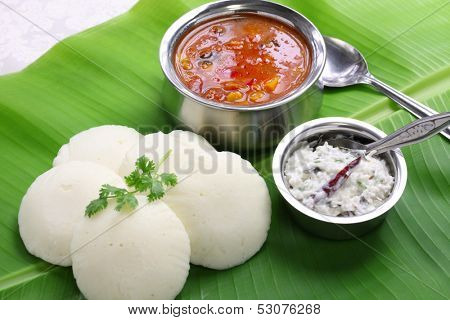 idli, sambar and coconut chutney, south indian breakfast on banana leaf