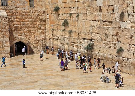 JERUSALEM - AUGUST 21: Prayers at Western Wall (aka Wailing Wall) - most important religious site in Judaism and one of popular places to visit for tourists in Jerusalem, Israel on August 21, 2013.