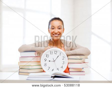 business, office, school and education concept - attractive woman showing clock