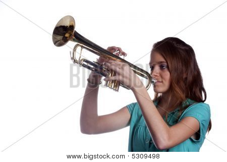 Teenage Girl Playing Trumpet Isolated