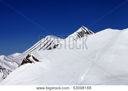 Off-piste Slope With Traces Of Skis In Nice Day