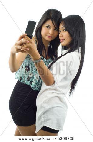 Mujeres asiáticas, tomar una fotografía de sí mismos