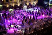 MOSCOW - MAY 25: Hall with tables and beautiful people under purple lights at 11th Viennese Ball in