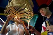 AMPANG - OCTOBER 9: Devotees of the Buddhism and Taoism faith light up the circular joss-sticks at t