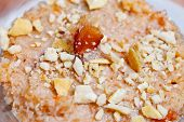 stock photo of halwa  - Grated coconut cooked and simmered with cream and nuts