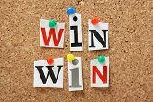 foto of jargon  - The phrase Win Win in cut out magazine letters pinned to a cork notice board - JPG
