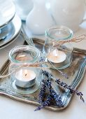 picture of crockery  - Dining table setting at Provence style with candles lavender vintage crockery and cutlery closeup - JPG