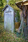 stock photo of outhouses  - An old rustic outhouse somewhere in rural Central New Jersey - JPG