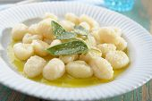 foto of shredded cheese  - Potato gnocchi dressed with olive oil - JPG