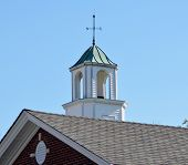 picture of wind vanes  - White cupola and wind vane on roof of library with decorative window with keystones - JPG