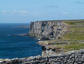 image of galway  - Dun Aonghasa or Dun Aengus is the most famous of several prehistoric forts on the Aran Islands of County Galway Ireland - JPG
