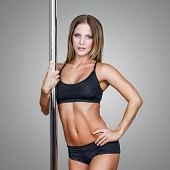 pic of pole dancer  - Sexy fit pole dancer posing blue eyes - JPG