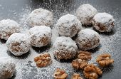 stock photo of confectioners  - Homemade walnut snowball cookies with confectioners sugar - JPG