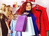 Shopping women at Christmas sales holding gift box.