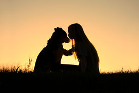 foto of pal  - a special and serene moment as a girl is lovingly hugging her large German Shepherd dog - JPG