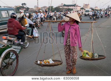 Woman With Baskets In Vietnam