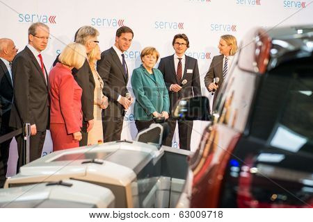 HANOVER, GERMANY - APRIL 7: German Chancellor Angela Merkel during a technology showcase tour of innovations in industrial Robotics used in the Automotive industry. 7 April 2014
