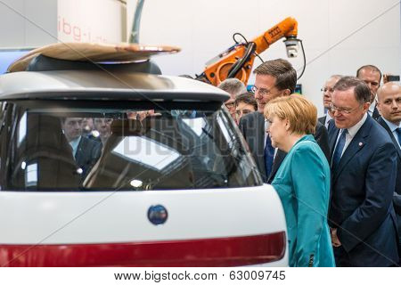 HANOVER, GERMANY - APRIL 7: German Chancellor Angela Merkel during a technology showcase tour of innovations in industrial Robotics used in the Automotive industry on 7 April 2014