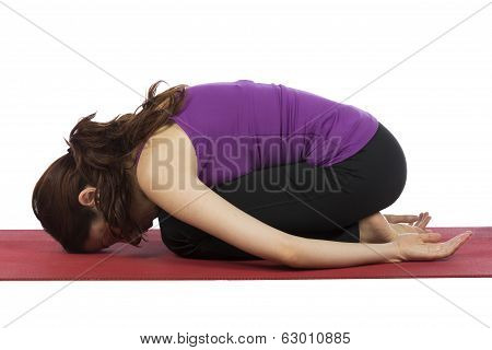 Woman In Child's Pose During Yoga