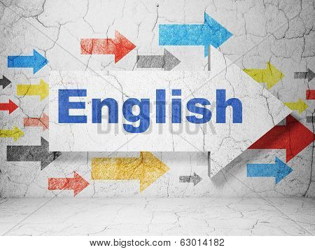 Education concept: arrow with English on grunge wall background