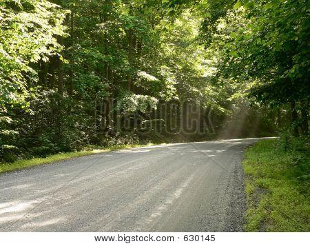 Vanishing Road With Sunbeams