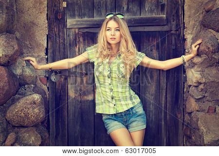 Portrait of Blonde Woman at the Wooden Door