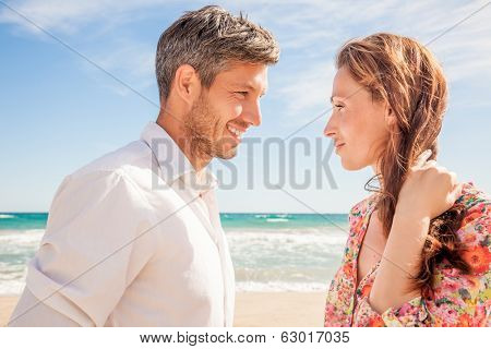 successful couple on beach flirting