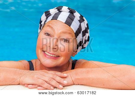 female senior workout smiling camera