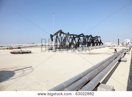 Black Oil Pump Jacks In The Desert