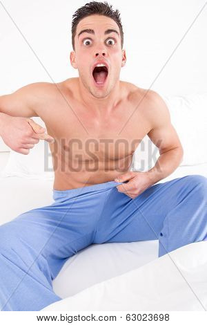 Upset Man On Bed In Pajamas Having Problems With Impotence