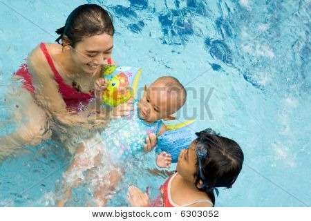 Mother Teach Baby To Swim