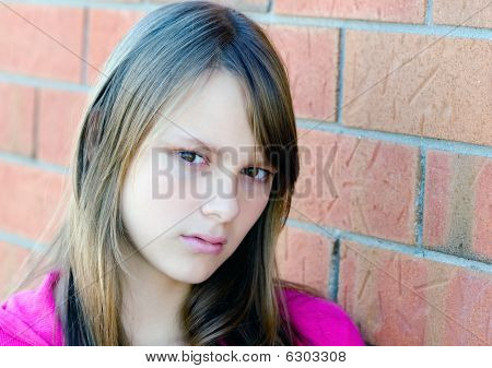 Portrait of a young beautiful teenager girl with serious thinking expression