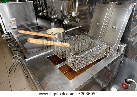 Deep fryers with oil on kitchen