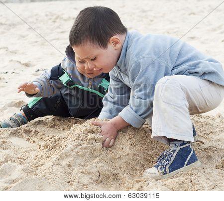 Children Building Sandcastle