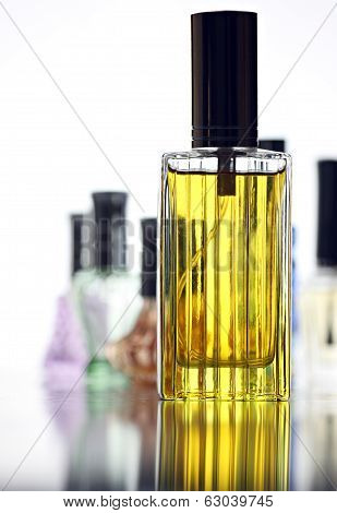 Many Bottle With Gold Perfume Different Color Isolated.