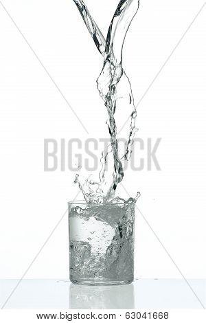 Fresh Flow Of Water Splashing In A Tranparent Glass