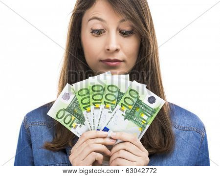 Beauitful woman holding some Euro currency notes, isolated over white background