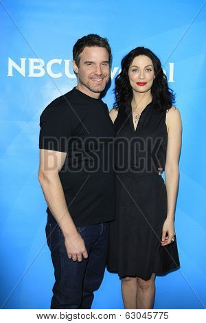 PASADENA - APR 8: Eddie McClintock, Joanne Kelly at the NBC/Universal's 2014 Summer Press Day held at the Langham Hotel on April 8, 2014 in Pasadena, California