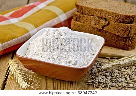 Flour Rye In Bowl With Bread On Board