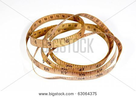 Studio Shot Coiled Vintage Tape Measure On White
