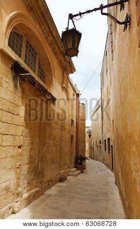 Traditional narrow street in Malta.