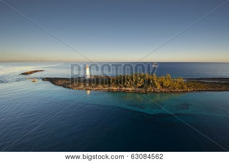 Lighthouse and sail ship at the tip of Paradise Island in Nassau, Bahamas
