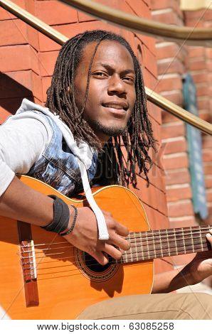 Young Black Man Playing Guitar