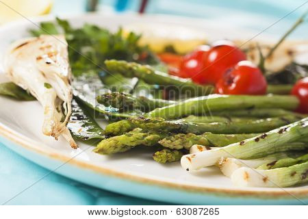spring marinated grilled vegetables - asparagus, onions, peas, tomatoes